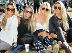 Leda Connaughton, Nicki Bailey, Bex Humphries and Johanna Ryan from Blackrock take in the evening sunshine on the first day of Longitude 2014 in Marlay Park. Photo: Tony Kinlan