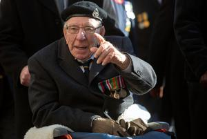 A war veteran gestures during the ceremony in London. Photo: Reuters