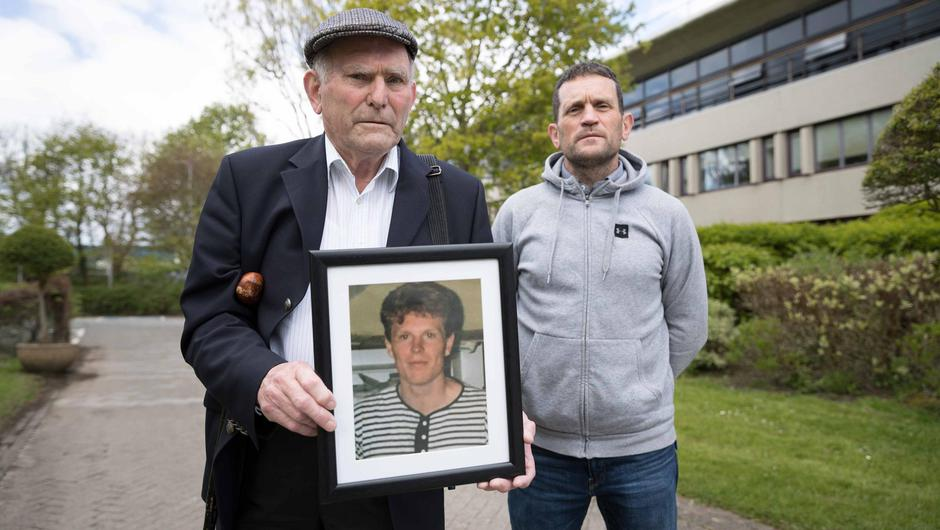 Denis Walsh and his son Michael with a photograph of Denis Walsh Jr at the inquest into his death at Galway Coroner's Court. Photo: Eamon Ward