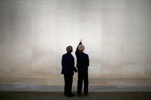 Two schoolchildren look at the names of the fallen soldiers at the National Memorial Arboretum in Alrewas, the UK, yesterday. Photo: Getty Images