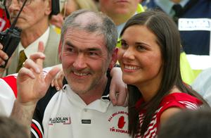 Tyrone manager Mickey Harte celebrates All-Ireland victory with daughter Michaela in 2003.