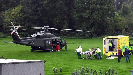 An injured man is taken to the army helicopter after fighting broke out at a funeral in Tuam.