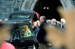 TJ Herlihy's coffin is removed from the church
