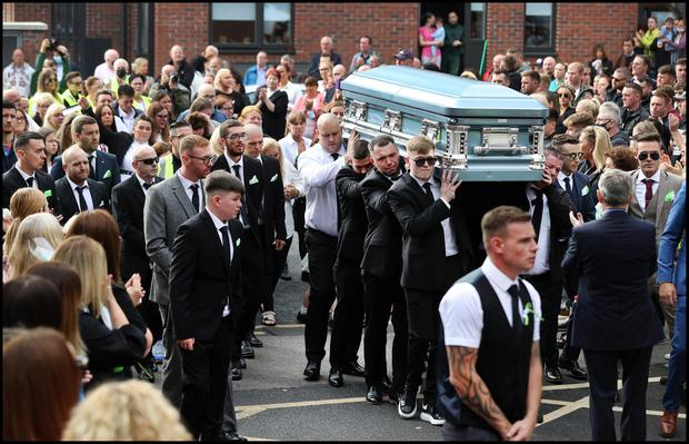 Mourners carry the remains of Cllr. Anthony                   (Anto) Flynn to the Church of our Lady of Lourdes on                   Sean McDermott Street.