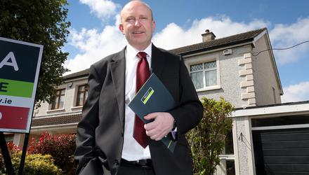 Auctioneer Anthony McGee outside one of his sold properties in Tallaght, Dublin. Photo: Frank McGrath