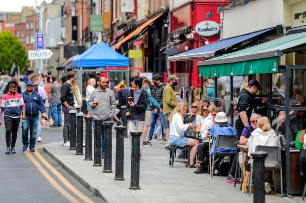 People enjoy the return of outdoor dining in Dublin city centre. Photo: Gerry Mooney