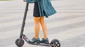 A woman using an electric scooter