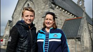 Garry O'Reilly (12) with his mother Sinead after he received a vaccination at TU Dublin Grangegorman. Picture by Steve Humphreys