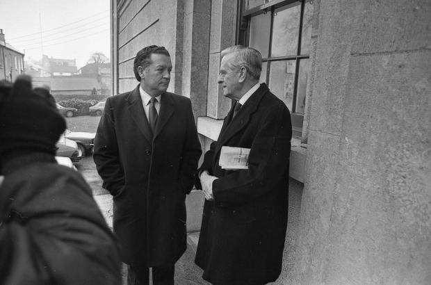 Richard Flynn, left, outside court in Tullamore with his solicitor