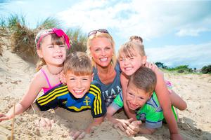 Glenda O'Leary and her children (left), Jessica (5), Amy (7) and twins Ben and Charlie (9) enjoying the sunshine on Morriscastle beach, Kilmuckridge, Co Wexford