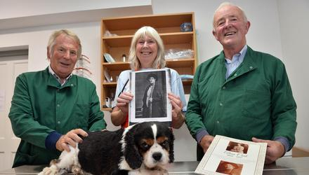 Vets Donal Connolly and Brendan Gardiner with Ascinta Kilroy holding a picture of Aleen Cust, along with Buddy the Cavalier King Charles. Photo: Ray Ryan