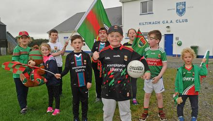Cullen O'Reilly, of Kiltimagh, was lucky enough to get a ticket for today's All-Ireland Football Final. He was joined in preparing for the big match by some of his friends at St Aidan's NS, Kiltimagh, Co Mayo. Photo Conor McKeown