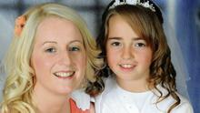 Zoe Scannell in her Communion dress with her mum Alisha