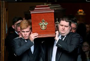 Mourners carry the remains of Johnny Lyons (right) from the Church of St Therese in Mount Merrion, Co Dublin