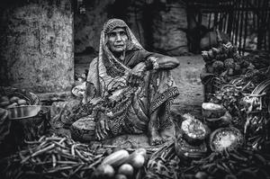 A market lady selling fruit and veg on the roadside in Varanasi, India. Picture:Arthur Carron