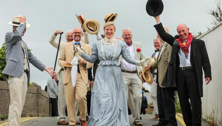 Local woman Nuala Carey in period dress is surrounded by fellow Joyceans in Sandycove to celebrate Bloomsday. Picture: Gerry Mooney