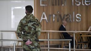 Members of the Defence Forces meet passengers arriving at Dublin Airport. Picture by Colin Keegan, Collins Dublin