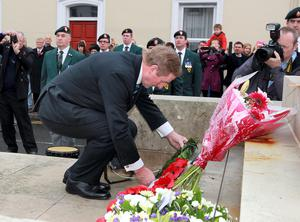 Taoiseach Enda Kenny lays a wreath on the cenotaph in Enniskillen. Photo: John McVitty