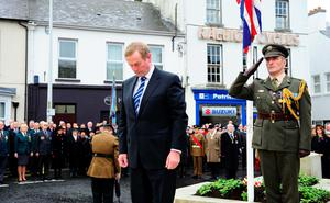 Enda Kenny lays a wreath in Enniskillen on Sunday. Photo: Mark Marlow/Pacemaker Press