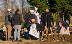 Mourners at Newcastle Cemetery, Co Dublin,                   yesterday for the the funerals of Seema Banu, her                   daughter Asfira and her son Faizan who were found dead                   at their home in Ballinteer, Dublin, last week. Photo:                   Collins