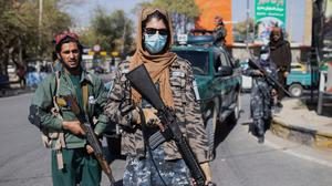 Taliban fighters stand guard during a women's protest in Kabul, Afghanistan, on October 21. Picture by Ahmad Halabisaz/AP