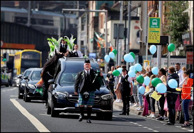 The funeral cortege of Cllr. Anthony (Anto)                     Flynn led by Piper Christy O'Brien heads towards the                     Inner City Helping Homeless offices on Amiens                     Street. Photo by Steve Humphreys