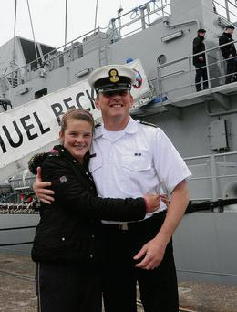 CPO Phil O'Connell is greeted by his daughter Allie after the arrival of the Irish Navy's latest ship the L. E. Samuel Beckett at Kennedy Quay in Cork for her twinning ceremony with Cork City.
