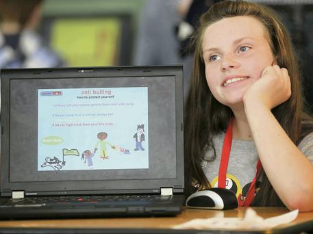 Kathleen Marie Maughan (age 11) from Clondalkin with her project 'Anti Bullying'.