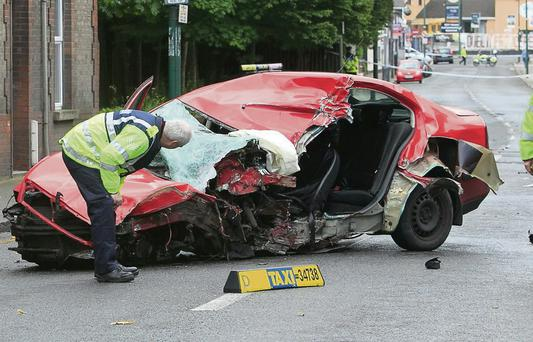Scenes of destruction on a Dublin city street after two men stole a taxi and crashed into a pole. Photo: Gareth Chaney
