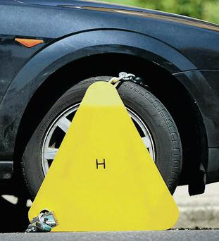 About 50 Dublin street parking services staff will get 2.5pc raise. File photo of a wheel clamped car. Photo credit: Chris Ison/PA Wire