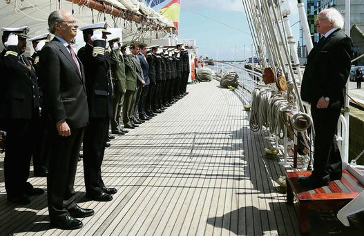 President Michael D. Higgins (right) is greeted by Spanish Ambassador to Ireland Javier Garrigues Florez (second left) as he arrives onboard the 'Juan Sebastian de Elcano at Sir John Rogersons Quay, Dublin.