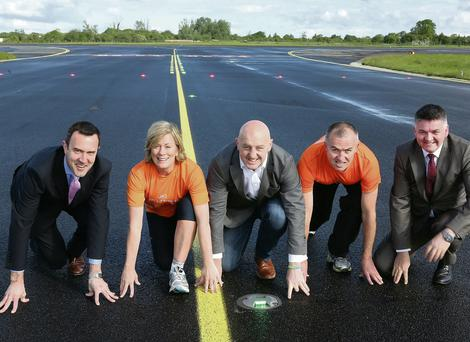 Andrew Murphy, Rose Hally, Keith Wood, Niall Moloney and Neil Pakey, chief executive Shannon Airport, launch the event yesterday on the Shannon runway. Liam Burke/Press 22