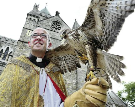 The Very Rev PM Dunne, Dean of Christ Church Cathedral, with the buzzard