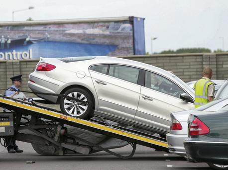 Gardai remove a car from the scene of the shooting in Balbriggan