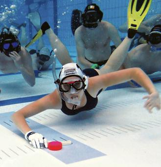 A competitor shows off her puck skills ahead of the Dublin Invitational Underwater Hockey tournament at the National Aquatic Centre today