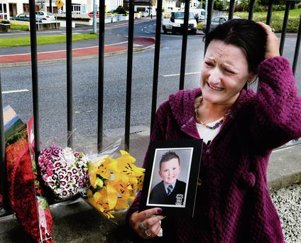 Roseann Brennan, the distraught mother of little Jake Brennan, at Lintown Grove where six-year-old died after a road accident. Photo: Colin O'Riordan