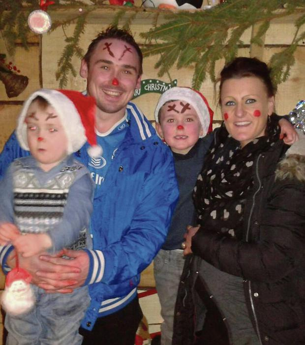 Last christmas: The family in happier times, from left, Kaelem (3), Chris, Jake (6) and Roseann Brennan