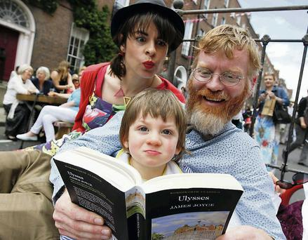 Emear McNally and Peter McNally with their son Myles yesterday at the Bizarre Bloomsday Brunch on North Great George Street. Photo: Conor McCabe photography