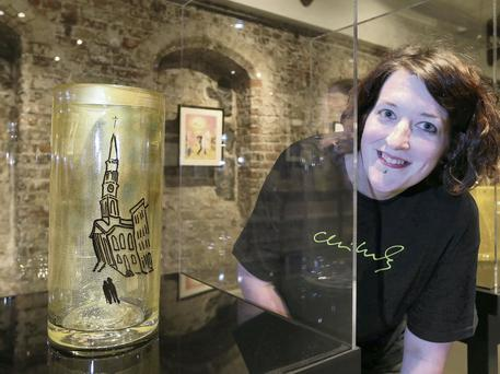 Sophie Longwell with one of the Ulysses Cylinders by Dale Chihuly
