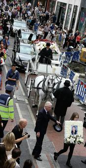 The funeral of Theresa Kelly passing through Grafton St where she sold flowers all her life. Martin Maher