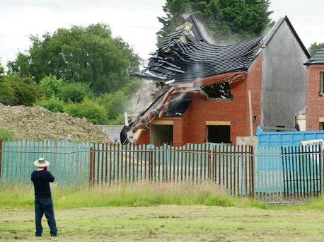 One of the houses in Drogheda, Co Louth, being demolished. Ciara Wilkinson