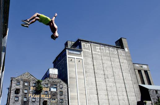 Sean Doran, above, jumps off the bridge at Boland's Mill on the Grand Canal Dock in Dublin last week