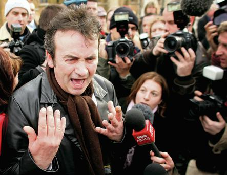 Gerry Conlon speaks to the media outside the Houses of Parliament in London in 2005