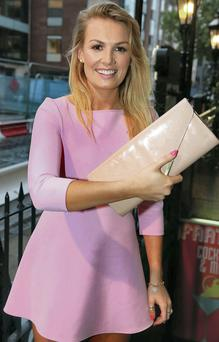 Kate Tierney after her bag was returned to her on Dawson Street in Dublin. Photo: Arthur Carron