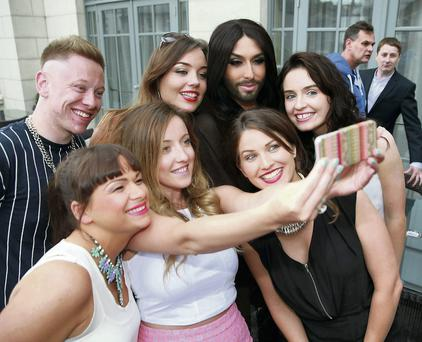 Conchita Wurst poses for a 'selfie' with fans at the Dylan Hotel, Dublin, yesterday. Cathal Burke