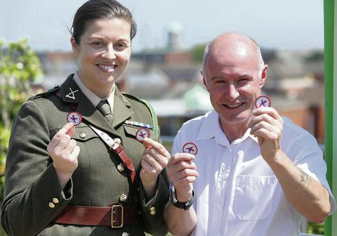 Captain, Gemma Fagan, and Mick Tynan, who served in the defence forces for 37 years, hold fushia badges at the launch of The Organisation of ex servicemen and woman's, (O.N.E), Fushia Appeal 2014