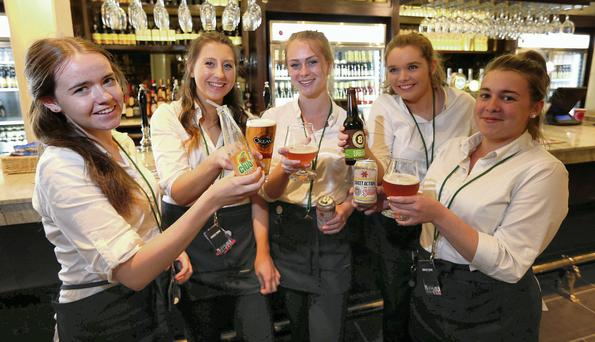Claire Lenehan, 19, Holly Kane, 20, Charlotte Bourke, 18, Eimear Green, 21, Ciara Foster, 22, bar staff in the new British pub group JD Weatherspoons pub, the Three Tun Tavern in Blackrock. Picture credit: Damien Eagers