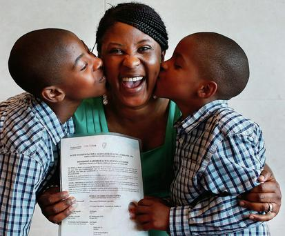 Oluwatoyin Ogundare and sons Tobi (10) and Sean, left, (6) were at yesterday's citizenship ceremony.