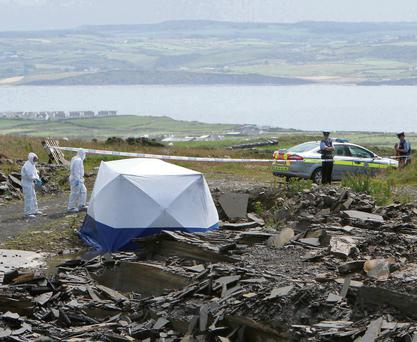 Garda at the scene on a body find believed to that of Adrian Folan at a quarry just a few hundred meters from the Cliffs of Moher. Picture Noel Gavin/Press 22