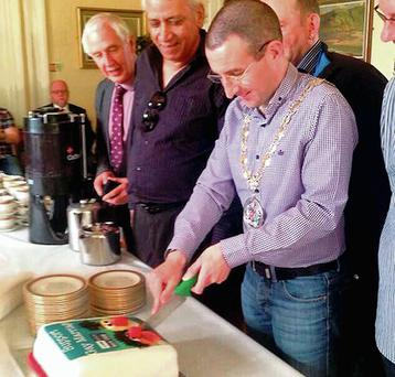 Northern Ireland Alliance Party councillor Andrew Muir cuts a specially baked Bert and Ernie cake to support gay marriage.